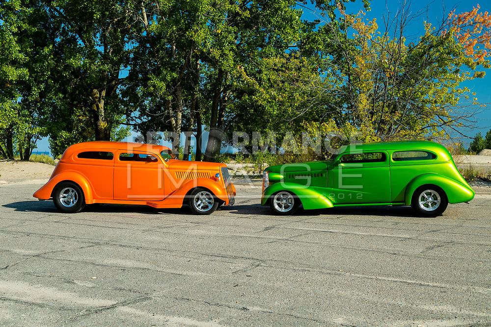 1935 Ford Sedan & 1938 Chevrolet Coach on pavement