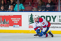 KELOWNA, CANADA - NOVEMBER 14: Andrei Pavlenko #25 of the Edmonton Oil Kings kneels on the ice with an upper body injury after against the Kelowna Rockets on November 14, 2017 at Prospera Place in Kelowna, British Columbia, Canada.  (Photo by Marissa Baecker/Shoot the Breeze)  *** Local Caption ***