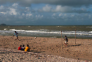 Boys playing football on the beach, Songkhla Province. The military own much of Thailand's coastline, preventing overdevelopment.