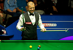 Barry Hawkins reacts after a missed shot against Stephen Maguire, on day twelve of the Betfred Snooker World Championships at the Crucible Theatre, Sheffield.