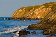 Striated cliffs of sedimentary rock showing uplift, on the coast at Gaviota Beach State Park, near Santa Barbara, California