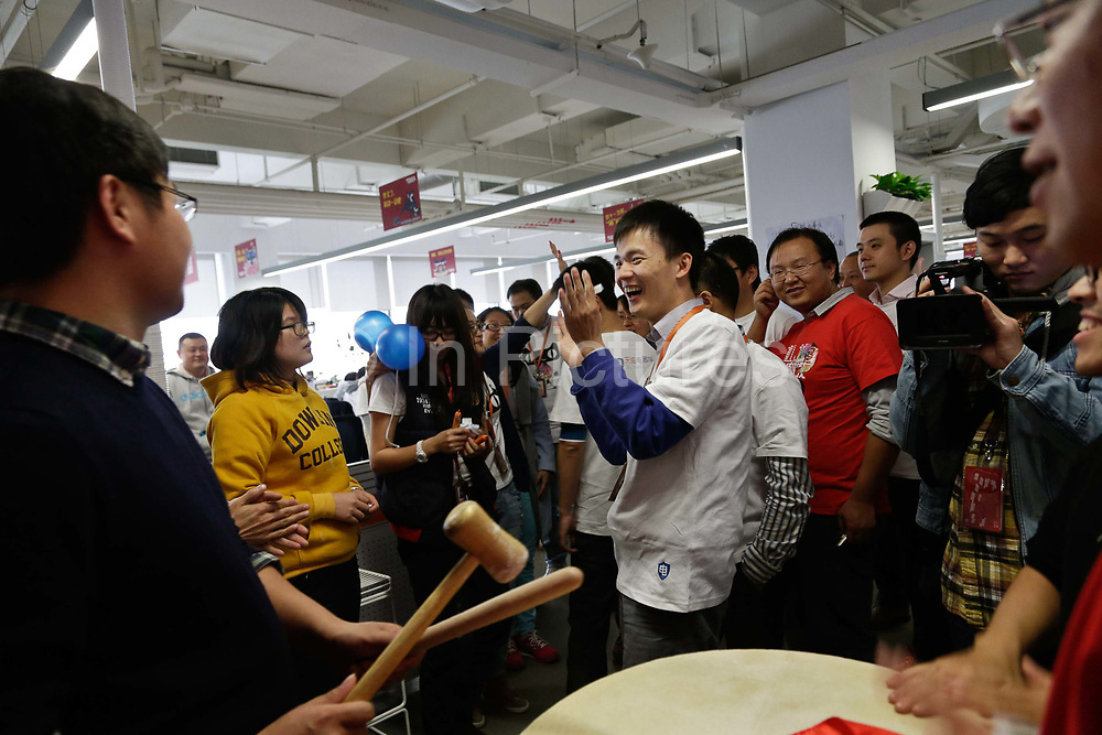 T Mall employees have a brief celebration as they meet certain sales targets during the November 11 shopping festival at Alibaba's head quarters in Hangzhou , China on 11 November 2013. Alibaba, the parent company of T Mall, recorded $5.78 billion of sales during this Chinese version of Black Friday in 2013, as people in China increasingly log on to their computers to shop.