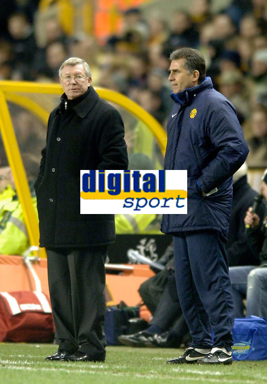 Photo: Glyn Thomas.<br />Wolverhampton Wanderers v Manchester United. The FA Cup. 29/01/2006.<br /> United's manager Sir Alex Ferguson (L) joins assistant Carlos Quieroz on the touchline for the second half.