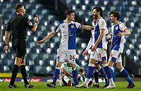 Blackburn Rovers' Darragh Lenihan holds teammates Joseph Rankin-Costello back during a confrontation with referee Robert Jones<br /> <br /> Photographer Alex Dodd/CameraSport<br /> <br /> The EFL Sky Bet Championship - Blackburn Rovers v Swansea City - Tuesday 9th March 2021 - Ewood Park - Blackburn<br /> <br /> World Copyright © 2021 CameraSport. All rights reserved. 43 Linden Ave. Countesthorpe. Leicester. England. LE8 5PG - Tel: +44 (0) 116 277 4147 - admin@camerasport.com - www.camerasport.com