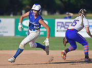 Freeburg batter Maleah Blomenkamp rounds second base after hitting a triple late in the game. At right is Nashville infielder Emmie Paskiewicz. Freeburg defeated Nashville in the Class 2A sectional softball title game at Nashville High School in Nashville, IL on Thursday June 10, 2021. Tim Vizer/Special to STLhighschoolsports.com.