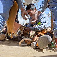 Wade Mailboy gets some tips on how to properly adjust his saddle during the D Largo Saddle Bronc school in Pinedale Saturday.