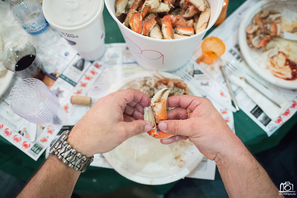 Guests crack crab claws during the Milpitas Chamber of Commerce Crab Feed at Napredak Hall in San Jose, California, on March 6, 2015. (Stan Olszewski/SOSKIphoto)
