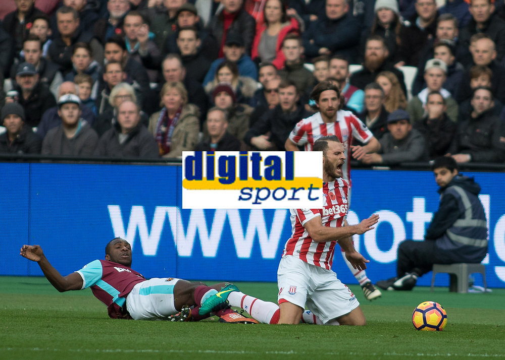 Football - 2016 / 2017 Premier League - West Ham United vs. Stoke City<br /> <br /> Ramadan Sobhi of Stoke City goes down after a challenge from behind by Michail Antonio of West Ham at The London Stadium.<br /> <br /> COLORSPORT/DANIEL BEARHAM