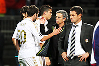 FOOTBALL - UEFA CHAMPIONS LEAGUE 2011/2012 - GROUP STAGE - GROUP D -<br />  LYON v REAL MADRID - 2/11/2011 - <br /> <br /> - JOY OF JOSE MOURINHO (MADRID COACH) WITH CRISTIANO RONALDO AND HIGUAIN (REAL) AND DESPITE OF REMY GARDE (COACH OF LYON) AFTER THE MATCH<br /> Norway only
