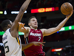 January 7, 2018 - Miami, FL, USA - Miami Heat guard Goran Dragic (0) tries to score as Utah Jazz's Derrick Favors (15) defends in the fourth quarter on Sunday, Jan. 7, 2018 at the AmericanAirlines Arena in Miami, Fla. The Miami Heat defeated the Utah Jazz, 103-102. (Credit Image: © Matias J. Ocner/TNS via ZUMA Wire)