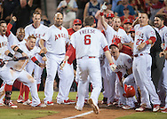 The Angels' celebrate at home plate after David Freese's walk-off home run to give the Halos' a 3-2 victory over the Seattle Mariners Saturday night at Angel Stadium.