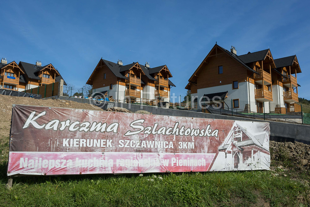 New short-stay tourist housing undergoing the final stages of construction, on 21st September 2019, in Jaworki, near Szczawnica, Malopolska, Poland. Local wealth has encouraged tourism appartments and short-stay properties in southern Poland mountain region, a very popular outdoor activity destination for city-dwelling Poles but at the cost of the local environment and landscape.