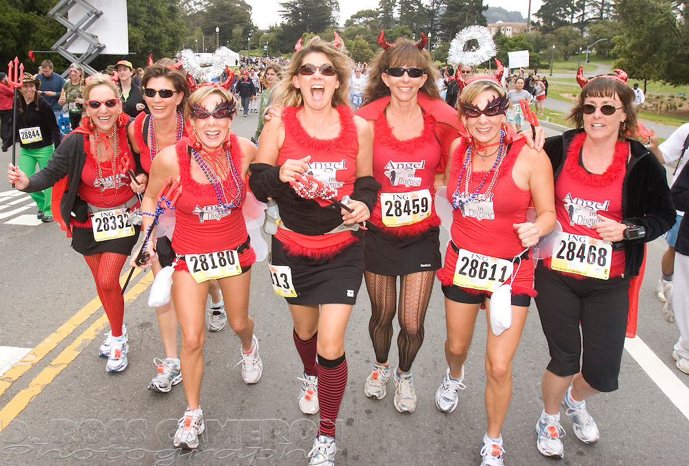 A group of devilish women from San Luis Obispo, Calif. mug for the camera as they pass through Golden Gate Park at the 99th running of the Bay to Breakers 12K race, Sunday, May 16, 2010 in San Francisco. (Photo by D. Ross Cameron)