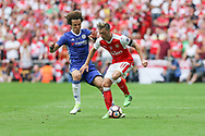 Arsenal's Mesut Özil(11) is challenged by Chelsea's David Luiz(30) during the The FA Cup final match between Arsenal and Chelsea at Wembley Stadium, London, England on 27 May 2017. Photo by Shane Healey.