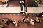 Mourners pause to view the body of slain State Senator Clementa Pinckney lying in State in the Capitol during public visitation June 24, 2015 in Columbia, South Carolina. Pinckney is one of the nine people killed in last weeks Charleston church massacre.