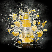 Bottle with lemon pieces and liquid permeating from the bottle on a black glossy surface Ray Massey is an established, award winning, UK professional  photographer, shooting creative advertising and editorial images from his stunning studio in a converted church in Camden Town, London NW1. Ray Massey specialises in drinks and liquids, still life and hands, product, gymnastics, special effects (sfx) and location photography. He is particularly known for dynamic high speed action shots of pours, bubbles, splashes and explosions in beers, champagnes, sodas, cocktails and beverages of all descriptions, as well as perfumes, paint, ink, water – even ice! Ray Massey works throughout the world with advertising agencies, designers, design groups, PR companies and directly with clients. He regularly manages the entire creative process, including post-production composition, manipulation and retouching, working with his team of retouchers to produce final images ready for publication.
