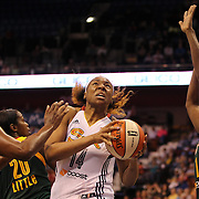 Kelsey Bone, (centre), Connecticut Sun, drives to the basket during the Connecticut Sun Vs Seattle Storm WNBA regular season game at Mohegan Sun Arena, Uncasville, Connecticut, USA. 23rd May 2014. Photo Tim Clayton