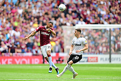 May 27, 2019 - London, England, United Kingdom - Ahmed Elmohamady (27) of Aston Villa heads the ball past Tom Lawrence (10) of Derby County during the Sky Bet Championship match between Aston Villa and Derby County at Wembley Stadium, London on Monday 27th May 2019. (Credit: Jon Hobley | MI News) (Credit Image: © Mi News/NurPhoto via ZUMA Press)
