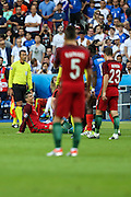 Cristiano Ronaldo from Portugal being assisted after injuried during the match against France. Portugal won the Euro Cup beating in the final home team France at Saint Denis stadium in Paris, after winning on extra-time by 1-0.