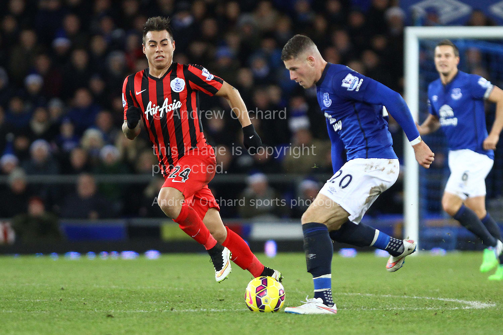 Ross Barkley of Everton being chased by Eduardo Vargas of Queens Park Rangers. Barclays Premier league match, Everton v Queens Park Rangers at Goodison Park in Liverpool, Merseyside on Monday 15th December 2014.<br /> pic by Chris Stading, Andrew Orchard sports photography.