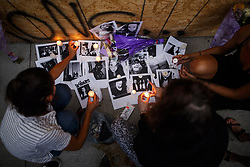 Friends of 18-year-old Danforth shooting victim Reese Fallon, leave candles on pictures of their friend Reese at a makeshift memorial remembering the victims of a shooting on Sunday evening on Danforth, Ave. in Toronto, ON, Canada, on Monday, July 23, 2018. Photo by Mark Blinch/CP/ABACAPRESS.COM