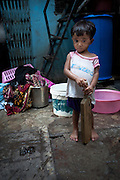 Boy with a Cricket Bat - Dharavi, Mumbai, India