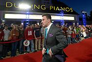 Texas A&M quarterback Johnny Manziel arrives on the red carpet for the College Football Awards show in Lake Buena Vista, Fla., Thursday, Dec. 12, 2013.(AP Photo/Phelan M. Ebenhack)