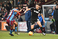 Jordan Clarke of Scunthorpe United and Yanic Wildschut of Wigan Athletic fight for the ball  during the Sky Bet League 1 match between Scunthorpe United and Wigan Athletic at Glanford Park, Scunthorpe, England on 2 January 2016. Photo by Ian Lyall.