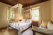 Quaint rustic decor of bedroom at Perleas Mansion guesthouse, Kampos, Chios, Greece