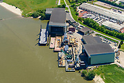 Nederland, Gelderland, Druten, 13-05-2019; Deest, Waalbandijk met Scheepswerf De Gerlien van Tiemen en Scheepswerf Ravestein.<br /> River Waal, branch of Rhine, shipyard.<br /> <br /> luchtfoto (toeslag op standard tarieven);<br /> aerial photo (additional fee required);<br /> copyright foto/photo Siebe Swart