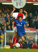 Photo: Scott Heavey<br />Chelsea v Arsenal. FA Cup quater final replay.<br />25/03/03<br />Edu clips the heels of Chelseas Gianfranco Zola during this London derby.