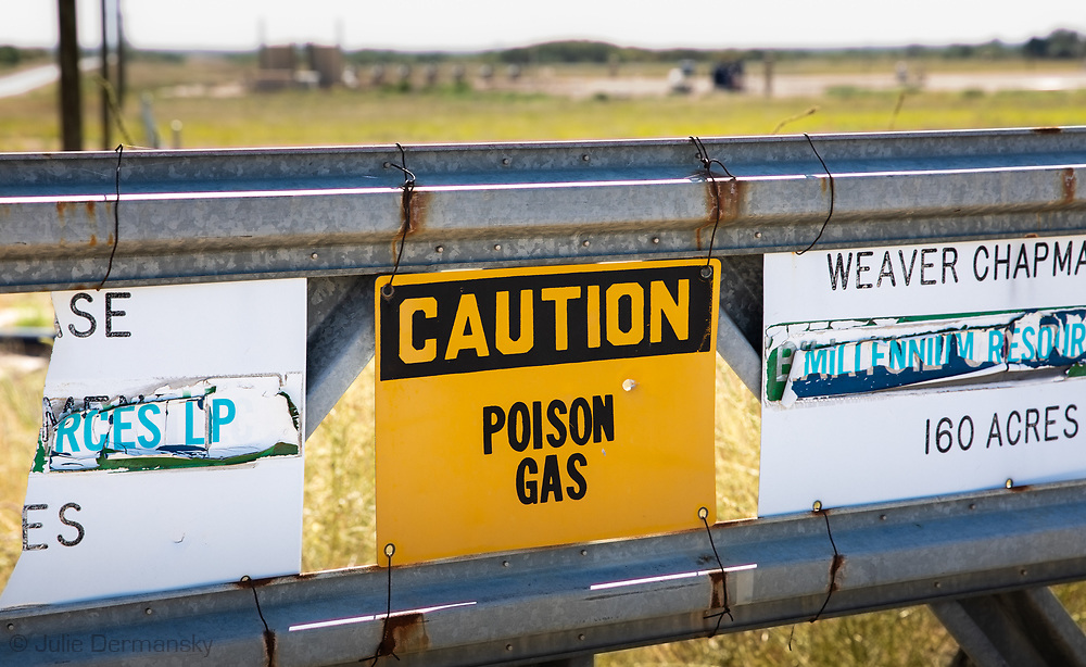 Poison gas warning sing at a fracking industry site in the Permain Basin.