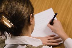 Woman writing at a table,