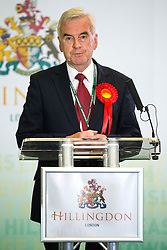 © Licensed to London News Pictures.  Current Shadow Chancellor of the Exchequer and Labour MP for Hayes and Harlington, JOHN MCDONNELL, makes a speech after winning his seat at the 2015 General Election count at Brunel University, London on May 8, 2015. Photo credit: Ben Cawthra/LNP
