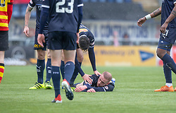 Falkirk's Zak Rubben after a tackle by Partick Thistle's Steven Saunders. Falkirk 1 v 1 Partick Thistle, Scottish Championship game played 16/3/2019 at The Falkirk Stadium.
