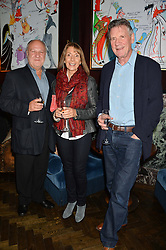 Left to right, HARVEY GOLDSMITH and his wife DIANA and MICHAEL PALIN at the Installation And Reveal Of Gerald Scarfe's Exclusive Artworks In Scarfes Bar at Rosewood Hotel, 252 High Holborn, London on 7th April 2014.