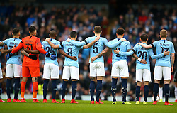 Manchester City players hold a minute silence for Emiliano Sala prior to kick-off during the FA Cup fourth round match at Etihad Stadium, Manchester.