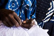 A man makes tie-dye cloth at the Village Artisanal de Ouagadougou, a cooperative that employs dozens of artisans who work in different mediums, in Ouagadougou, Burkina Faso, on Monday November 3, 2008.