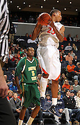 Dec. 20, 2010; Charlottesville, VA, USA; Virginia Cavaliers forward Akil Mitchell (25) grabs a rebound in front of Norfolk State Spartans forward Tim Zephyr (5) during the game at the John Paul Jones Arena. Mandatory Credit: Andrew Shurtleff