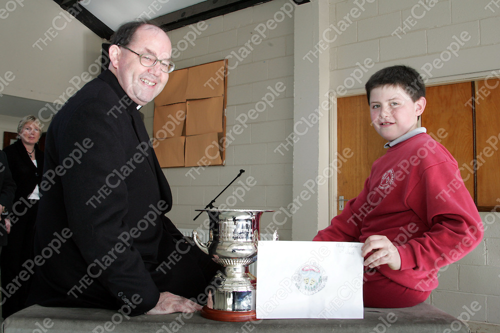 Philip Coleman, Cratloe winner of the Castlewood Players logo design competition pictured with Father Liam Enright at St John National Schoool, Cratloe. Pic Sean Curtin Press 22.