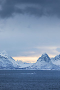 Scenic view of snow-capped mountain range against cloudy sky, Sortland, Norway