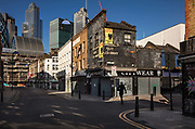 A closed Petticoat Lane market overlooked by City of London skyline during the coronavirus pandemic on the 2nd May 2020 in London, United Kingdom.
