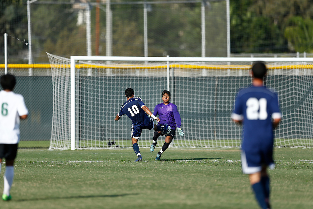 Golden West College goal keeper stops goal attempt by Fullerton forward Eduin Munigua. <br /> <br /> Photo by Ozzy Jaime, Sports Shooter Academy
