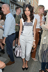 GEMMA CHAN at the Calvin Klein Jeans X mytheresa.com launch the Re-Issue Project at 37 Rathbone Street, London on 17th July 2014.