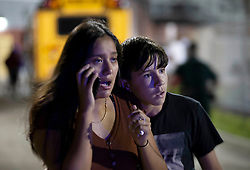 August 18, 2018 - Wellington, Florida, U.S. - Gunfire sent players and fans screaming and stampeding in panic during the fourth quarter of the game at Palm Beach Central High School in Wellington, Florida on August 17, 2018. Two adults were shot Friday night at a football game between Palm Beach Central and William T. Dwyer high schools, authorities said. (Credit Image: © Allen Eyestone/The Palm Beach Post via ZUMA Wire)
