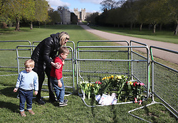 Floral tribute being left by the Long Walk at Windsor Castle, Berkshire, following the death of the Duke of Edinburgh at the age of 99 on April 10. Picture date: Thursday April 15, 2021.