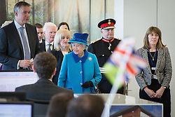 © Licensed to London News Pictures . 14/11/2013 . Manchester , UK . The Queen tours the offices . Queen Elizabeth II and the Duke of Edinburgh visit the Coop building at 1 Angel Square , Manchester , this morning ( 14th November 2013 ) . Photo credit : Joel Goodman/LNP