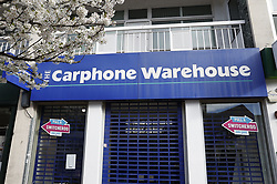 "© Licensed to London News Pictures. 17/03/2020. London, UK. A Carphone Warehouse shop remains closed in Kingston-Upon-Thames after it was announced that all stand-alone shops would cease trading today with the loss of 2900 jobs. The government have advised the public that they should avoid ""non-essential"" travel and contact with others to curb the spread of the coronavirus. Photo credit: Peter Macdiarmid/LNP"