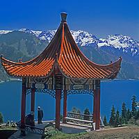 A pagoda rises above Heaven Lake in the Tian Shan Mountains of Xinjiang, China, near Urumqi.