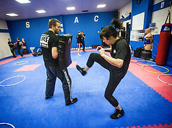 Students practise kicking pads as Stef Noij, KMG Instructor from the Institute Krav Maga Netherlands, takes the IKMS G Level Programme seminar today at the Scottish Martial Arts Centre, Alloa.
